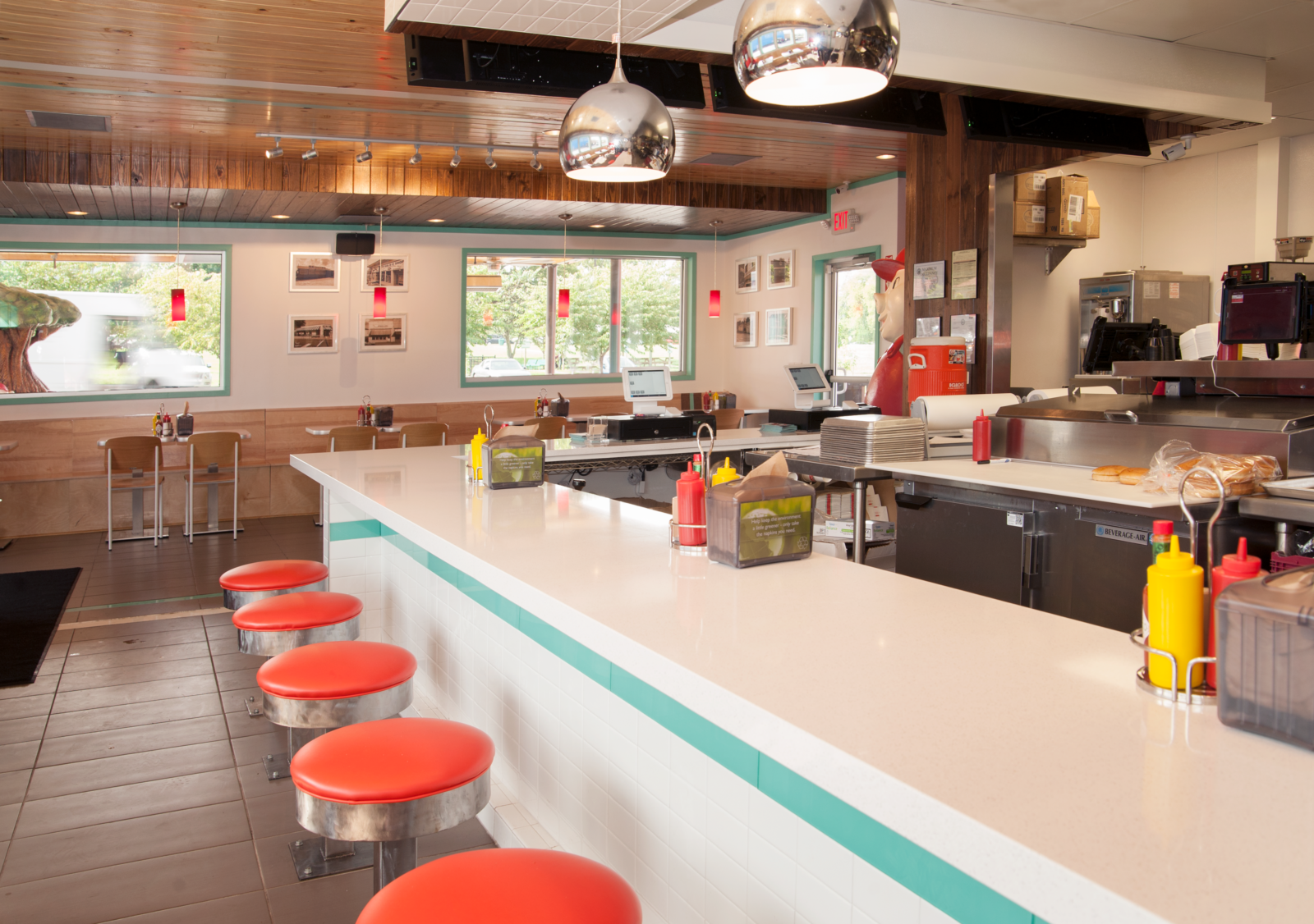 The interior lunch counter in Hugh Baby's with red retro counter stools.