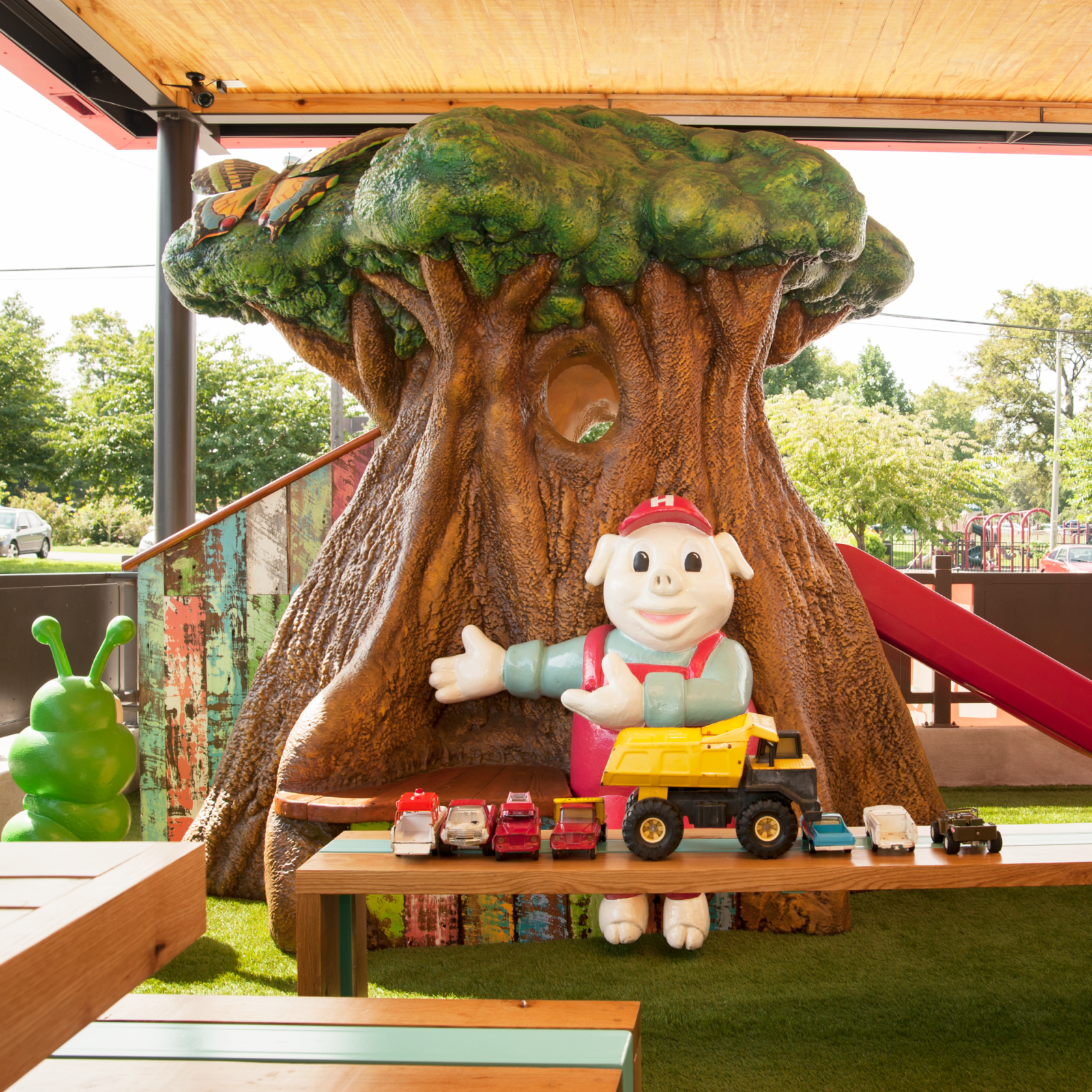 The child's play-set tree on the patio at Hugh Baby's/