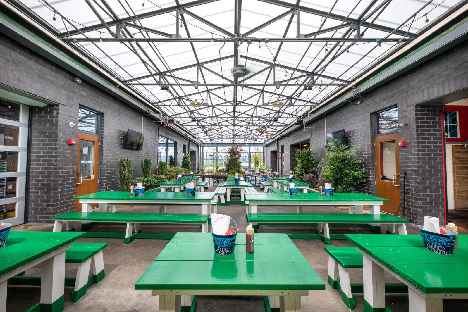 The covered patio of Martin's with green and white picnic tables.