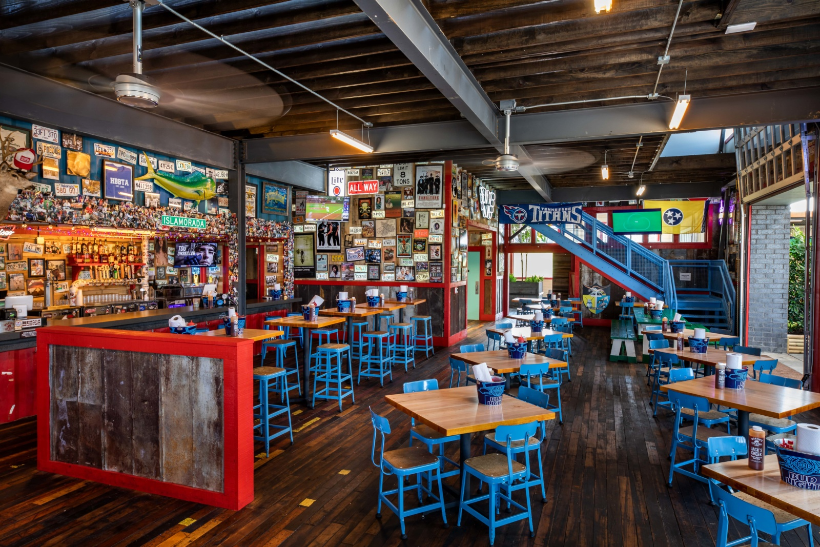 The dining room of Martin's BBQ with the blue and red branding colors throughout.